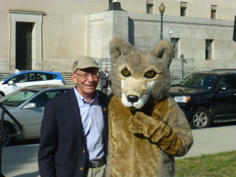 """Rep. Peter DeFazio with """"Journey"""" the wolf outside the Department of Interior."""