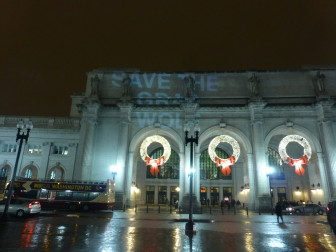 SAVE THE GRAY WOLF projected onto Union Station in Washington, DC.
