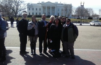 Great Lakes wolf advocates in front of the White House.